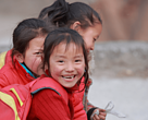 Three Baima Zang minority girls going home after school, Chengdu, China